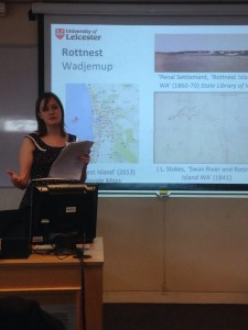 Shows presenter Katy Roscoe talking in front of powerpoint which shows maps of Rottnest