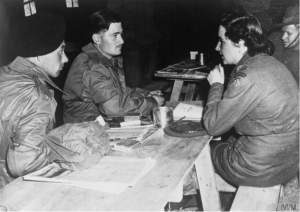 "A member of the British Red Cross, chats to two young repatriated prisoners of war at ""Freedom Village"" near Panmunjon in Korea. ©Imperial War Museum. http://www.iwm.org.uk/collections/item/object/205191706 A member of the British Red Cross, chats to two young repatriated prisoners of war at ""Freedom Village"" near Panmunjon in Korea."
