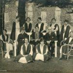 Students and staff, 1922. Back row: R. Bennett, W. Bates, M. Nevitt, M. Webb, G. K. Smalley. Middle row: E. Capey, Miss C. E. C. Measham, Dr. R. F. Rattray, W. G. Gibbs, N. Bonser. Front row: D. Ough, D Gilbert.