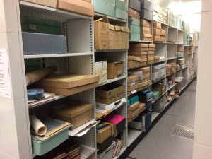 Photograph of newly-acquired archives waiting for processing.