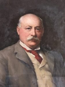 Portrait of Harry Simpson Gee, with a plaque saying 'Presented by the Shareholders of the Leicestershire Banking Company Ltd to Harry Simpson Gee Esq in recognition of his long services as Director and Chairman.'