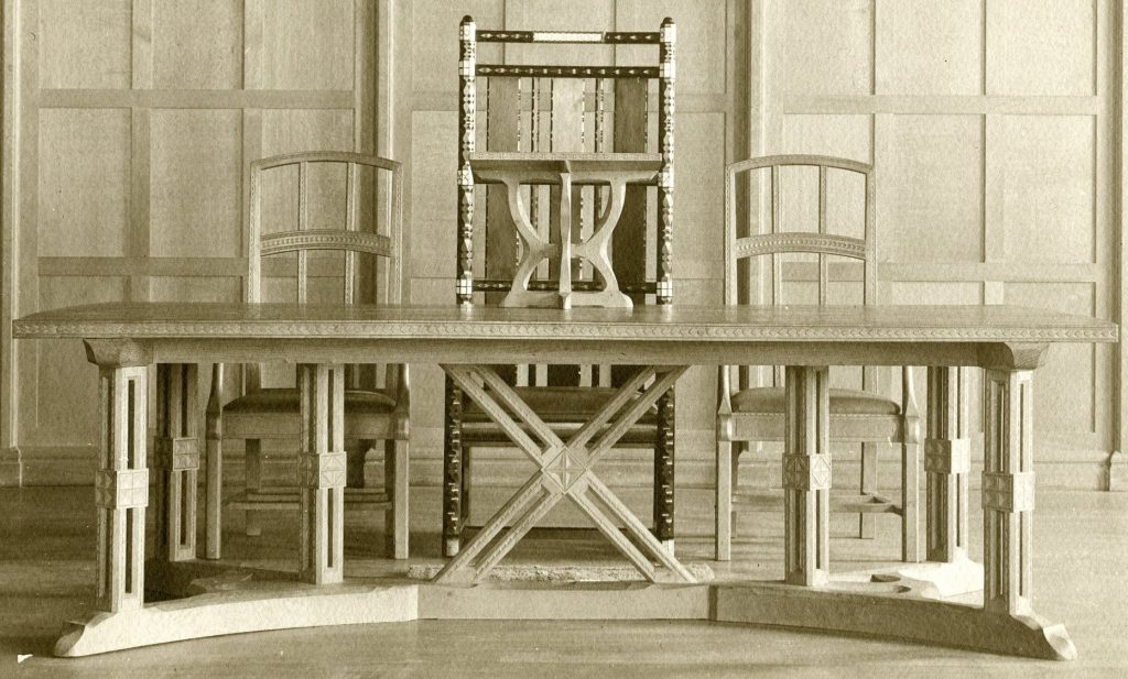 Black and white photograph of the wooden 'Cholerton' chair and a table and 2 chairs made by Ernest Gimson. These were gifts made to University College, Leicester.