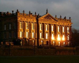 The sun setting on the West Front of Chatsworth House..
