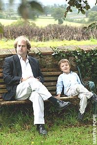Alexander and Bron Waugh on garden bench