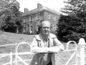 Auberon Waugh stands in front of Combe Florey House